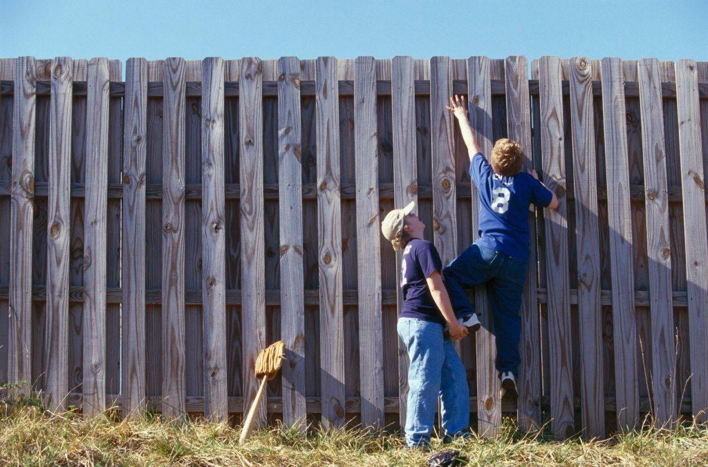 kids climbing a fence