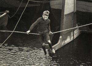 young maverick crossing water